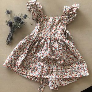 Handmade pinafore dress for baby. No label